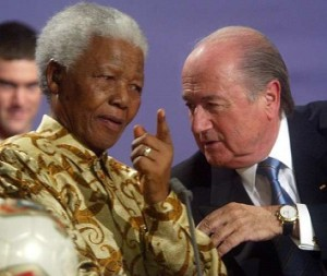 For Web Edition-The late Nelson Mandela with Sepp Blatter